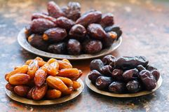 Various of dried dates or kurma in a vintage plates. Close up Stock Photo
