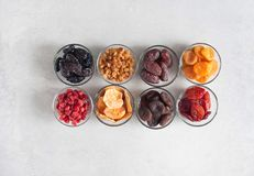 Dried fruits. Various Dried fruit in glass bowls on a gray background Royalty Free Stock Photos