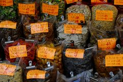 Various dried fruit and nuts. Bags of dried fruit and nuts for sale royalty free stock photography