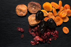 Various dried fruits: apricots, figs, prunes, cranberries Stock Image