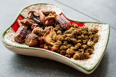 Various Dried Fruits Date, Fig, Mulberry, Apricot and Jujube Assortment in Selection Plate. stock image