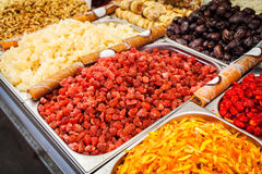 Various dried fruits on the Mahane Yehuda Market. Close-up of different dried fruits in metal boxes. The counter on the Mahane Yehuda Market in Jerusalem Stock Photo