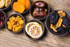 Various dried fruits in small bowls Royalty Free Stock Photography