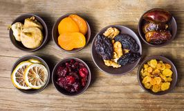Various dried fruits in small bowls Royalty Free Stock Images