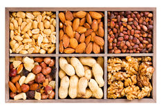 Various dried nuts in wooden box Royalty Free Stock Photos