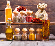 Various dried spices on wooden background Royalty Free Stock Photos