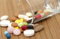 Various drugs in small glass Stock Photo