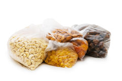 Various dry fruits in the bags Stock Photos