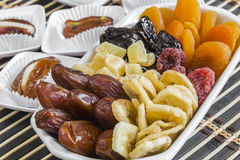 Various dry fruits in a bowl and dry dates stuffed Stock Photography