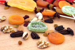 Colorful dried fruits for the Jewish holiday of Tu Bishvat. Various dry fruits on a wooden table background for the Jewish holiday of Tu BiShvat stock photos