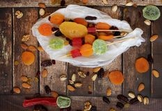Colorful dried fruits for the Jewish holiday of Tu Bishvat. Various dry fruits on a wooden table background for the Jewish holiday of Tu BiShvat royalty free stock photos