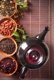 Various dry tea in small bowls Royalty Free Stock Photography