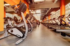 Various dumbbells in gym a bright orange interior Stock Image