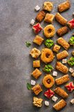 Various Eastern sweets on a rustic brown background. Baklava, delight, cookies. Top view, copy space stock images