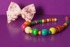 Various elastic bands, hair clips, beads, bows for girls. Various elastic bands, hair clips, beads, bows for girls royalty free stock image