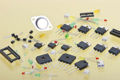 Various electronic components. On a yellow background Stock Photo