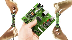 Various electronic microcircuits in their hands Royalty Free Stock Image