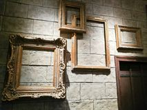 Various empty vintage photo frames on brick wall. Various empty old wooden vintage photo frames on brick wall Royalty Free Stock Photo