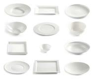 Various empty white plates Stock Photos