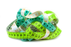 Various entangled measuring tape. Royalty Free Stock Photo