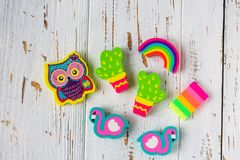 Various erasers in the form of owls, cacti, flamingos and rainbows stock photography