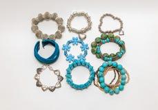 Various fashionable pretty stylish bracelets isolated on grey background Royalty Free Stock Photo