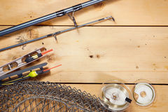 Various fishing gears on wooden boards Royalty Free Stock Photo