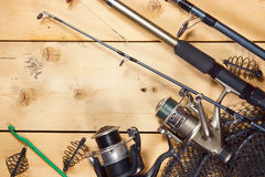 Various fishing tackles on wooden boards. Various fishing tackles on wooden background Royalty Free Stock Images