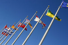 Various flags. In a blue sky Stock Image