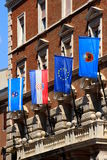 Various flags on the facade of town hall, Rijeka city, Croatia. Flag of the county, the state, the European Union and the city on the facade of town hall of Stock Photos