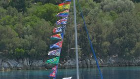 Various Flags on Ship Mast. Yacht passing with various signaling mast stock video