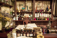 Various flasks, jars and herbs on the shelves  in old pharmacy Royalty Free Stock Image