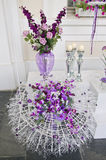 Various flower florist arrangement in glass vase Stock Photo