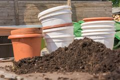 Flowerpots and potting while repotting in the garden stock image