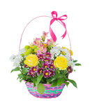 Various flowers in basket Stock Images