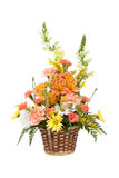 Various flowers in basket on white Stock Images