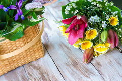 Various flowers on the table and flowers basket Stock Photo