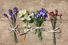 Various flowers on the wooden table. Various flowers on the wooden, rustic table Stock Photos