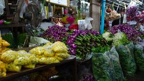 Various flowers in a market hall in the evening stock photo