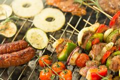 Various food on the grill Royalty Free Stock Photography