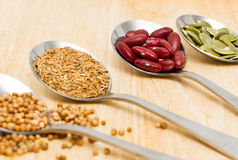 Grains in spoon. Collection of grains in spoon Royalty Free Stock Images