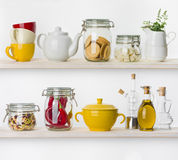 Various food ingredients and utensils on kitchen shelves isolated Royalty Free Stock Images