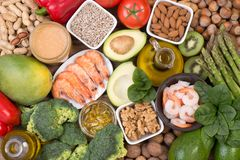 Vitamine E food sources, top view on wooden background. Various food sources of vitamine E, top view on wooden background Stock Photo