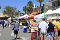 Various Food Vendors at the Farmers Market. The Villages, FL, USA -April 1, 2017: Various food vendors at a farmer's market. People lined up at the street royalty free stock image