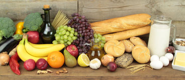 Various foods, mixet on wood background Stock Image
