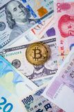 Various foreign currencies and gold coin bitcoin. Stock Photos