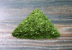 Various forms of parsley. On a wooden background Royalty Free Stock Photos