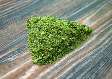 Various forms of parsley. On a wooden background Royalty Free Stock Images