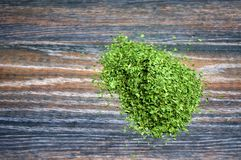 Various forms of parsley. On a wooden background Stock Photography