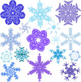 Various forms, sizes and colors of snowflakes Royalty Free Stock Images